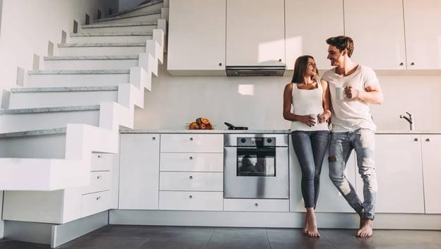 couple talking inside home