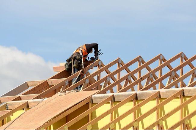 roofing contractor repairing roof